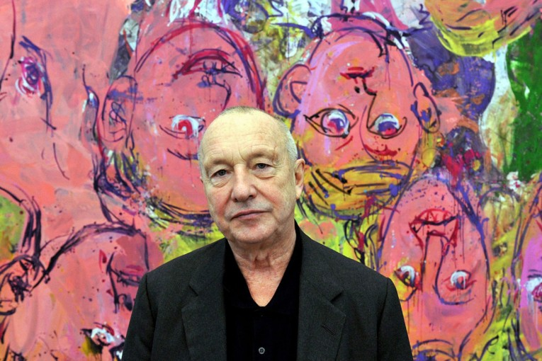 epa01939572 A picture made available on 20 November 2009 shows artist Georg Baselitz posing in front of the painting 'Us At Home' at the Museum Frieder Burda in Baden-Baden, Germany, 17 November 2009. 'Baselitz. A Retrospective' running from 21 November 2009 to 14 March 2010 at the Museum Frieder Burda, features a comprehensive insight into the work of Georg Baselitz.  EPA/ROLF HAID